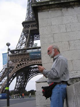 Dennis Baxter reading near the Eiffel Tower